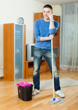 Smiling man with mop royalty free stock images