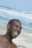 Smiling man near the raging Atlantic Ocean, Malika beach, Senegal. Smiling man near the raging Atlantic Ocean, Malika beach,  Senegal Stock Photography