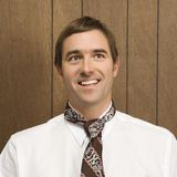 Smiling man with necktie. Stock Photos
