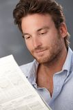 Smiling man with newspaper Stock Photo