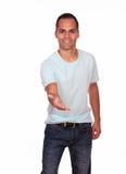 Smiling man offering handshake at you Royalty Free Stock Image