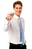 Smiling man offering house key Stock Photography