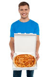 Smiling man offering pizza to you Royalty Free Stock Image