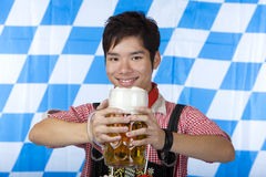 Smiling man with Oktoberfest beer stein (Mass) Stock Photography