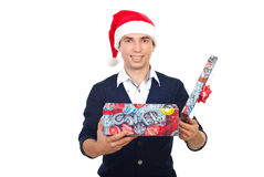 Smiling man with open Christmas gift Royalty Free Stock Photos