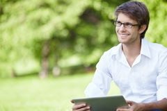 Smiling man outdoors Royalty Free Stock Image