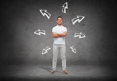 Smiling man over arrow doodles background Royalty Free Stock Image