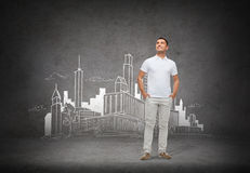 Smiling man over city sketch background Royalty Free Stock Photography