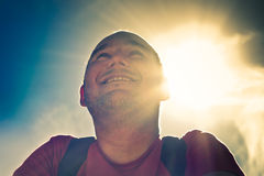 Smiling man over sunny sky Royalty Free Stock Images
