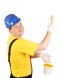 Smiling man in overall. Royalty Free Stock Image