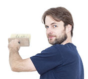Smiling man with a paint brush isolated on white Royalty Free Stock Photography