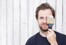 Smiling man with paint brush - renovation Royalty Free Stock Images
