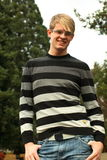 Smiling man at park. A stylish and smiling young man at the park Stock Image