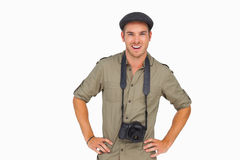 Smiling man in peaked cap with camera around his neck. On white background Stock Photo
