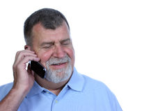 Smiling Man on Phone. A smiling man talks on a cell phone Stock Image
