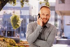 Smiling man on phone call Royalty Free Stock Image