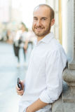 Smiling man with phone Royalty Free Stock Photography