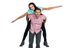 Smiling man with piggy back to his girlfriend Stock Images