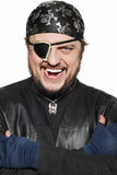 Smiling man in a pirate costume. Isolated Stock Photography