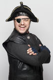 Smiling man in a pirate costume.  royalty free stock photos