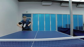 Smiling man playing the table tennis at the court stock video footage