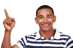 Smiling man pointing. Smiling latino male pointing up, horizontal image with copy space Royalty Free Stock Images