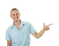 Smiling man pointing aside Stock Image