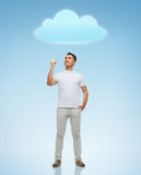 Smiling man pointing finger up to cloud Stock Photography