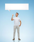 Smiling man pointing finger up to text bubble Royalty Free Stock Photos