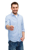 Smiling man pointing finger at you Stock Photos