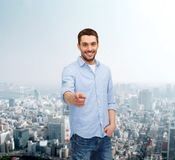 Smiling man pointing finger at you Stock Photography