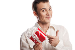 Smiling man pointing on gift isolated Stock Photos