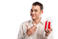 Smiling man pointing on gift isolated Royalty Free Stock Photo