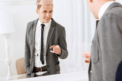Smiling man pointing on himself in mirror Royalty Free Stock Photos