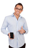 Smiling man pointing to his mobile royalty free stock photography