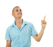Smiling man pointing up Stock Photography