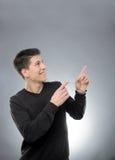 Smiling man pointing upward Royalty Free Stock Image