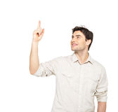 Smiling man points with finger on something Royalty Free Stock Photography