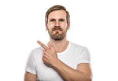 Smiling man points to an empty space.. Royalty Free Stock Photography