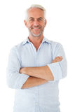 Smiling man posing with arms crossed Stock Photos