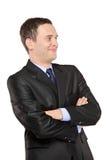 Smiling man posing in black suit Royalty Free Stock Photo