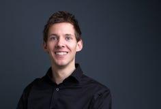 Smiling man posing on gray background Stock Photos