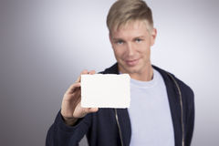 Smiling man presenting empty white card. Stock Photography
