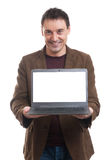 Smiling man presenting his laptop screen Royalty Free Stock Image