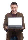 Smiling man presenting his laptop screen Royalty Free Stock Image