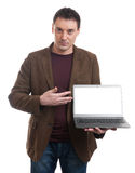 Smiling man presenting his laptop screen Royalty Free Stock Photos