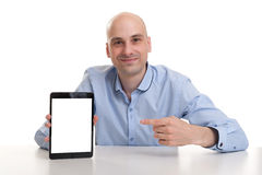 Smiling man presenting website on tablet Royalty Free Stock Image