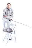 Smiling man professional fencer holding rapier and looking at camera Royalty Free Stock Images