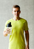 Smiling man with protein shake bottle Royalty Free Stock Photo