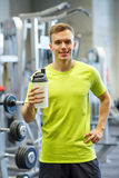Smiling man with protein shake bottle Royalty Free Stock Images